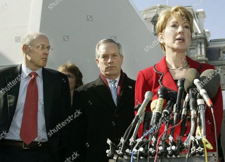 Stock Photo of Ceo of Hewlett-packard Carly Fiorina (r) Talks to the Press with Us Secretary of Commerce Donald Evans (c) and Ceo of Goldman Sachs Henry Paulson (l) at the White House in Washington On Tuesday 10 February 2004