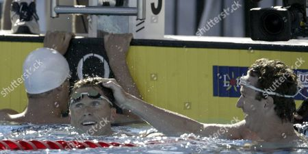 Aaron Peirsol (r) Puts His Hand On the Head of Lenny Krayzelburg After Winning the Men's 100 Metre Backstroke Final at the Us Olympic Swim Trials in Long Beach California Friday 09 July 2004 Peirsol Won the Race with a Time of 53 64 and Krayzelburg Took Second with a Time of 54 06 Dan Westcott Finishes Fifth