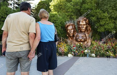 'It's Very Sad ' Says Christine Passingham Right Along with Her Husband Patrick Passingham As They Look at Flowers Placed out by a Statue of Siegfried & Roy at the Mirage Hotel and Casino in Las Vegas Sunday Oct 5 2003 Magician Roy Horn of Siegfried & Roy Was Mauled by a Tiger Onstage On Friday and is Critical Condition in Hospital