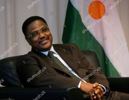 Stock Photo of Niger's Prime Minister Seyni Oumarou (l) Smiles As He Waits For a Meeting with European Union Foreign Policy Chief Javier Solana Prior to a Meeting at the Eu Council in Brussels Belgium 25 October 2007