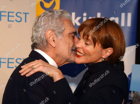 Actor Omar Sharif (l) and Leigh Taylor Young His Co-star in the Film 'The Horsemen' Embrace Warmly During the Tribute to Actor Sharif at the Arclight in Hollywood California 12 November 2003 the Afi Los Angeles International Film Festival 2003 Honors Sharif to Recognize His Legacy As the Recipient of the Afi 2003 Tribute From His Early Days As an Actor in Arab Cinema in Films Such As Youssef Chahine's 'The Blazing Sun' (1954) to His Emergence As One of Hollywood's Most Sought-after Movie Stars Omar Sharif's Career Has Spanned 50 Years with Appearances in More Than 70 Films