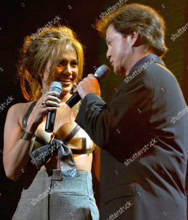 Us Singer and Actress Jennifer Lopez (l) and Rick Dees Host the 3rd Annual Jingle Ball Held at the Staples Center in Los Angeles Friday 05 December 2003