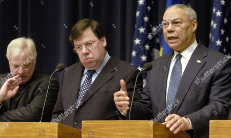 Us Secretary of State Colin Powell (r) Makes Remarks As Irish Foreign Minister and Current European Union President Brian Cowen (c) and Eu External Affairs Commissioner Christopher Patten Listen at a News Conference 1 March 2004 in Washington the Officials Discussed Closer Us-eu Ties On Iraq the Middle East and Trade Issues