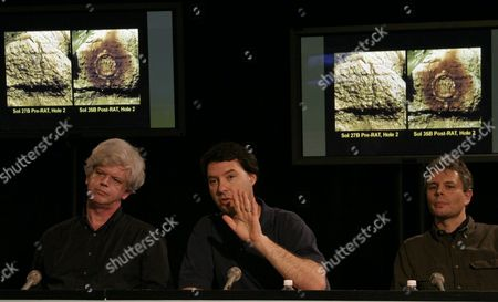 Dr Jim Bell Lead Scientist For Panoramic Camera Cornell University Explains the Images That Show a Hole Drilled Mars Rovers Opportunity Which Allowed Scientist to Confirm Evidence of Past Water Activity in the Volcanic Rock the Images in the Background Show Hole 2 Shot First On Sol 27 Then Sol 36 the News Briefing Was Held at the Jet Propulsion Laboratory in Pasadena California 05 March 2004 Bell is Flanked by Stephen Gorevan (left) Lead Scientist For Rock Abrasion Tool Honeybee Robotics and Dr Morten Madsen (right) Science Team Member Center For Planetary Science Copenhagen