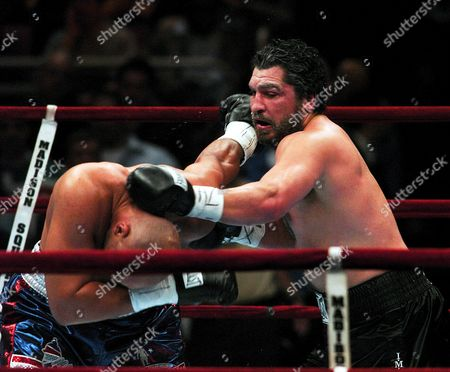 Us Boxer John Ruiz (l) Punches Fres Oquendo (r) of Puerto Rico During Their Wba Heavyweight Title Bout at Madison Square Garden in New York City Saturday 17 April 2004