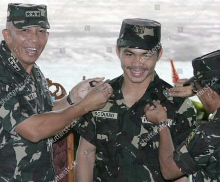 Filipino Boxing Hero Manny Pacquiao (c) Recieves His Two-rank Promotion From Army Chief General Alexander Yano (l) at Army Headquarters in Taguig City South of Manila Philippines On 12 October 2007 Pacquiao Was Honoured and Promoted to Master Sergeant in the Reserve Force After Keeping His Wbc International Super Featherweight Title Via Unanimous Decision Against Mexican Boxer Marco Antonio Barrera at the Mandalay Bay Event Centre in Las Vegas Usa On 06 October 2007