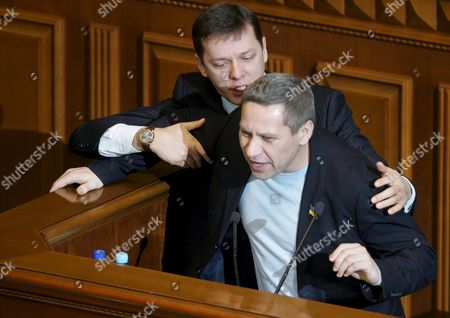 Deputy of Pro-russian Party of Regions Vladyslav Lukyanov (front) is Physically Restrained by a Deputy of Yulia Tymoshenko's Bloc Oleg Lyashko (r) On the Speaker's Podium During the Morning Session of the Ukrainian Parliament in Kiev 13 December 2007 Ukrainian Reformers Suffered an Defeat On Tuesday by Trying But Failing to Elect Politician Yulia Tymoshenko the Countrys New Prime Minister a Vote in the National Legislature the Verhovna Rada Showed 225 Mps in Support of Tymoshenkos Candidacy with 226 Ayes Needed in the 450-seat House