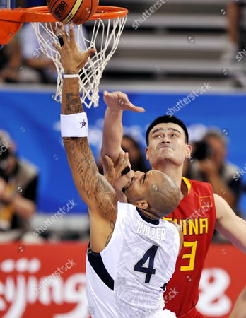 Yao Ming and Carlos Boozer. China men's basketball team 70:101 US in a preliminary match during the Beijing Olympic Games.