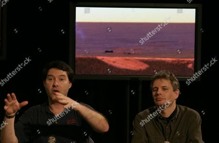 Dr Jim Bell (l) Lead Scientist For Panoramic Camera Cornell University Explains a Panoramic Image Showing a Very Flat Mars Surface the Image Also Shows the Point of Touch Down and Points of Bounce Impacts of the Rover the News Briefing Was Held at Jet Propulsion Laboratory in Pasadena California On Friday 05 March 2004 with Bell is Dr Morten Madsen Science Team Member Center For Planetary Science Copenhagan