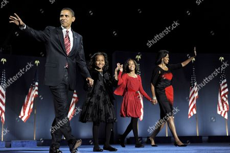 Democratic Presidential Candidate Barack Obama Walks Onstage with His Family (l-r) Natasha Malia and His Wife Michelle As They Arrives to Address a Crowd at Grant Park in Chicago Illinois Usa to Celebrate His Victory on Election Day 04 November 2008 the First Anniversary of Obama's Inauguration As the 44th President of the United States is 20 January 2010 Obama's Election As the First Black President of the United States Generated Massive Attention He was Celebrated by a World Which Expected Him to Instantly Reverse the Eight Years of Unpopular George W Bush But Obama Entered Office Facing a Daunting Set of Challenges Rivaled by Only a Handful of His Predecessors He Inherited the Worst Economy in Decades Wars in Iraq and Afghanistan and a Sullied Us Image in the World After Years of Hard-line Policies Against Terrorism Headlined by the Guantanamo Bay Prison a Year Later the Reality is More Sobering: Soaring Unemployment Ramped-up Troop Commitments to Afghanistan and Stalled Nuclear Talks with Iran and North Korea Obama Failed to Keep His Promise to Close Guantanamo by 22 January 2010 and Also Disappointed Europe on Global Warming He Presided Over the Biggest Government Bailout of Private Companies Like General Motors in Decades Aside From the Hard Political Issues of the Day Obama and First Lady Michelle Obama Created a Celebrity Frenzy Unlike Anything Since John F and Jackie Kennedy Moved Into the White House in 1961 Daughters Malia and Sasha First Dog Bo and an Organic Garden on the Front Lawn Have Captured Popular Sentiment United States Chicago