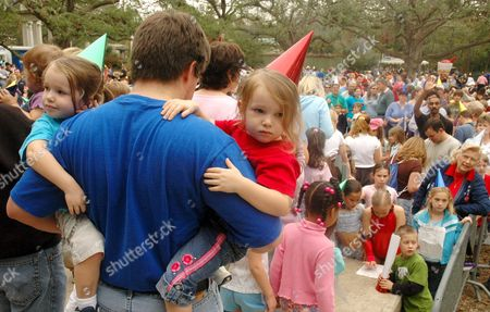 Erik Noble and His Two and a Half Year Old Twin Daughters Jade Left and Ruth Celebrate New Year's Eve at Audubon Zoo in New Orleans 31 December 2005 Residents Are Hoping to Leave 2005 Behind Along with Bad Memories of Hurricane Katrina Which Devastated the Gulf Coast in August