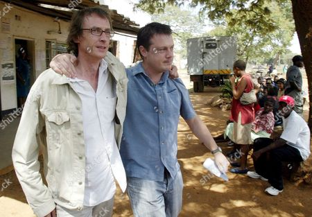 Stock Photo of British Journalists Julian Simmons (l) and Toby Harnden Embrace After They Were Acquitted at the Court in Norton Zimbabwe 40 Km (25 Miles) West of Harare Thursday 15 April 2005 the Two Journalists Working For British Broadsheet the Sunday Telegraph Were Arrested After They Were Caught Allegedly Covering Pre-election Activities in Zimbabwe Without Accreditation
