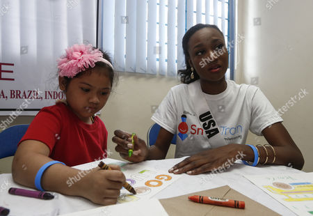 Miss Universe candidate Deshauna Barber from the USA (R) and a child beneficiary (L) of a charitable institution helping cleft patients make colorful posters with messages for candidates, during a visit to the Our Lady of Peace Hospital in Paranaque City, south of Manila, Philippines 20 January 2017. A total of 86 candidates are vying for the 65th Miss Universe crown, with the coronation event scheduled for 30 January.