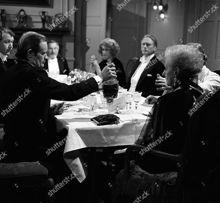 Stock Picture of Stephen MacDonald as Dr. George McDee; David McCallum as Steel; Davy Kaye as Lord Mullrine; Joanna Lumley as Sapphire; Jeffrey Wickham as Felix Harborough; Patience Collier as Emma Mullrine - from TV series Sapphire And Steel: Adventure Five: Doctor McDee Must Die