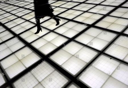 A Woman Walks On an Illuminated Floor at the Tokyo International Forum in Tokyo Japan 24 February 2008 Designed by Uruguay Born Architect Rafael Vinoly the Forum Opened in 1997 to Become an Important Urban Landmark in the Japanese Megalopolis with Its Exhibition and Concert Halls