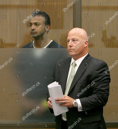 Shelley Malil stands with his attorney Sean Leslie