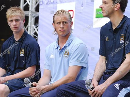 (l-r) Manchester City's Players Young Shinning Star Benjamin Mee Danish Goalkeeper Kasper Schmeichel and German Midfielder Dietmar Harmann Look On During a Press Conference 'Manchester City Fc Super Match Thailand 2008' at a Shopping Centre in Bangkok Thailand 15 May 2008 the English Manchester City Soccer Club Which's Owned by Thai Deposed Prime Minister Thaksin Shinawatra is in the Kingdom to Play Their Friendly Match with Thailand Premier All Stars On 17 May 2008 Which Part of Their Asian Tour to Promote the Club