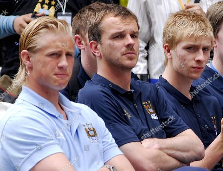 (l-r) Manchester City's Players Danish Goalkeeper Kasper Schmeichel German Midfielder Dietmar Harmann and Young Shinning Star Benjamin Mee Look On During a 'Manchester City Fc Super Match Thailand 2008' at a Shopping Centre in Bangkok Thailand 15 May 2008 the English Manchester City Soccer Club Which's Owned by Thai Deposed Prime Minister Thaksin Shinawatra is in the Kingdom to Play Their Friendly Match with Thailand Premier All Stars On 17 May 2008 Which Part of Their Asian Tour to Promote the Club