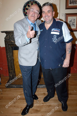 Jim Bowen and Phil 'The Power' Taylor, champion professional darts player