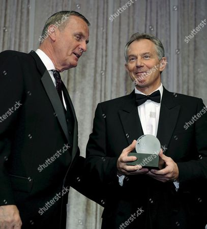 In This File Photo Dated 21 April 2008 Former British Prime Minister Tony Blair (r) is Escorted to the Podium by Former U S Marine Corps General James L Jones (l) at the Atlantic Council of the United State's 2008 Gala Dinner in Washington Retired Marine General James L Jones the Former Head of Nato and U S Forces in Europe Has Emerged As the Leading Candidate to Serve As the National Security Adviser For President-elect Obama According to Us Media Reports On 20 November 2008