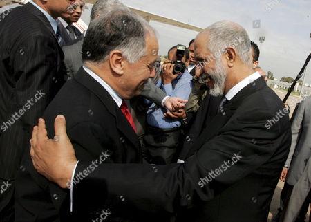 Stock Photo of Algeria's Prime Minister Abdelaziz Belkhadem (r ) Shakes Hands with His Libyan Counterpart Baghdadi Al-al-mahmoudi (l ) During a Welcoming Ceremony Held at Houari Boumedine in Algiers City Algeria 17 May 2008