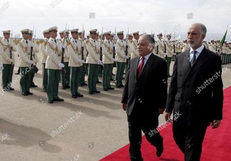 Algerian Prime Minister Abdelaziz Belkhadem (r ) and His Libyan Counterpart Baghdadi Al-al-mahmoudi (c) Review the Honour Guard During a Welcoming Ceremony Held at Houari Boumedine in Algiers City Algeria 17 May 2008