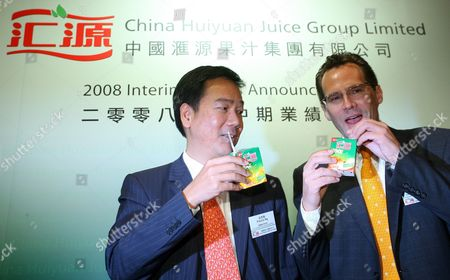 Francis Ng( L) Vic President and Chief Financial Offer and Matthew Gene Mouw Stragic Devement Vice President of China Huiyuan Juice Group Limited Pose For a Photo During the Company's 2008 Interim Results Press Conference in Hong Kong China 10 September 2008 Us Soft Drinks Company Coca-cola Announced On 03 September It Planned to Invest Hk$17 9 Billion (1 58 Billion Euros) to Buy a Controlling Stake in Huiyuan China Huiyuan Juice Group Limited the County's Largest Juice Company the Other Chinese Juice Makers Will Protest to the Government Against Coca-cola Co's Bid the Official China Securities Journal Said On Tuesday