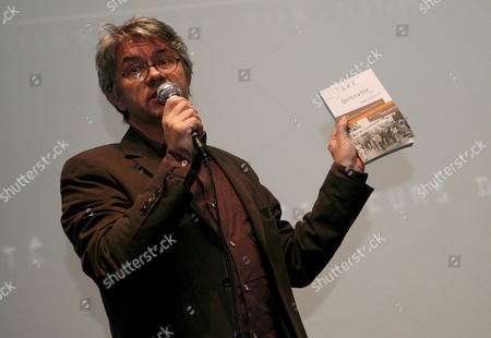 French Film Director Christian Vincent Shows the Book From the French Directors Society About the Directors' Fortnight to the Media During the Presentation of the 40th Edition of the Directors Fortnight in Paris France 25 April 2008 Born From the Movment of May 1968 the Directors Fortnight That Was Created by the Srf ( French Driectors Society) Programs a Selection of Films From Around the World During the Cannes Film Festival the 40th Edition of the Directors Fortnight Will Run From 15 May to 25 May 2008 in Cannes France