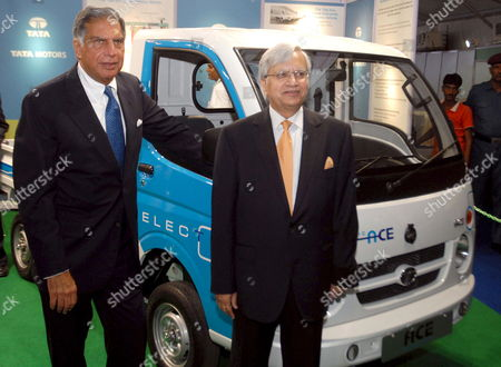 Chairman of India's Tata Motors Ratan Tata (l) and Tata Motors Managing Director Ravi Kant Pose with Their Electrical Vehicle 'Ace Tempo' Being Displayed at the 48th Annual Convention of Society of Indian Automobile Manufacturers (siam) in New Delhi India 04 September 2008 This Year the Annual Convention by Siam is Held with Emphasis On Celebrating the Successes of 60 Years of Indian Automobile Manufacturing
