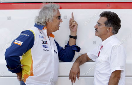 German Dr Mario Theissen (r) Motorsport Director of Bmw Sauber Talks to Italian Flavio Briatore (l) Team Director of Renault Prior to the Start of the Grand Prix of Europe at Valencia Street Circuit in Valencia Spain On 24 August 2008