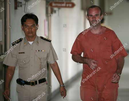 Canadian Paedophile Suspect Christopher Paul Neil (r) Walks Next to a Thai Prison Officer As He Departs Criminal Court in Bangkok Thailand 30 June 2008 Neil Was Arrested in Thailand Last Year After German Police ' Unswirled ' His Digitally Altered Image On Internet Photographs That Showed Him Abusing a Dozen Young Boys in Cambodia and Vietnam Some Appearing to Be Well Under 10 Years Old Neil 32 Was Arrested After Fleeing South Korea a Week Earlier Following the Release of His Picture by Interpol with a Red Alert Its Highest Search Signal He is Suspected of Having Abused Scores Possibly Hundreds of Boys - Some As Young As Six - and Girls Neil is Standing Trial in Thailand For Allegedly Abusing Boys During His Time As an English Teacher in Bangkok in 2003