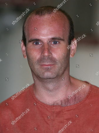 Canadian Paedophile Suspect Christopher Paul Neil is Seen During His Trail at Criminal Court in Bangkok Thailand 30 June 2008 Neil Was Arrested in Thailand Last Year After German Police ' Unswirled ' His Digitally Altered Image On Internet Photographs That Showed Him Abusing a Dozen Young Boys in Cambodia and Vietnam Some Appearing to Be Well Under 10 Years Old Neil 32 Was Arrested After Fleeing South Korea a Week Earlier Following the Release of His Picture by Interpol with a Red Alert Its Highest Search Signal He is Suspected of Having Abused Scores Possibly Hundreds of Boys - Some As Young As Six - and Girls Neil is Standing Trial in Thailand For Allegedly Abusing Boys During His Time As an English Teacher in Bangkok in 2003