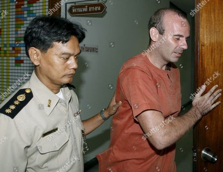 Canadian Paedophile Suspect Christopher Paul Neil (r) is Escorted by a Thai Prison Officer After His Trial at Criminal Court in Bangkok Thailand 30 June 2008 Neil Was Arrested in Thailand Last Year After German Police ' Unswirled ' His Digitally Altered Image On Internet Photographs That Showed Him Abusing a Dozen Young Boys in Cambodia and Vietnam Some Appearing to Be Well Under 10 Years Old Neil 32 Was Arrested After Fleeing South Korea a Week Earlier Following the Release of His Picture by Interpol with a Red Alert Its Highest Search Signal He is Suspected of Having Abused Scores Possibly Hundreds of Boys - Some As Young As Six - and Girls Neil is Standing Trial in Thailand For Allegedly Abusing Boys During His Time As an English Teacher in Bangkok in 2003