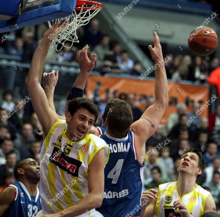 Mirsad Turkcan (l) of Fenerbahce Ulker From Turkey Fights For the Ball with Jared Homan (r) of Cibona Zagreb During Their Euroleague Basketball Game in Zagreb 12 February 2009