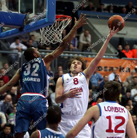 Matjaz Smodis of Cska Moscow (r) Shoots a Ball Over Alan Anderson of Cibona Zagreb (l) During the Euroleague Basketball Match in Zagreb 11 March 2009