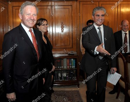 British Envoy to Afghanistan and Pakistan Sherard Cowper-coles (l) Meets Pakistan's Foreign Minister Shah Mehmood Qureshi (r) in Islamabad Pakistan On 24 April 2009 Britain Appointed Sherard Cowper-coles As Special Envoy For the Two Countries That Are Being Described in Western Diplomatic Circles As the Major Cause For Concern in Coming Days and Months