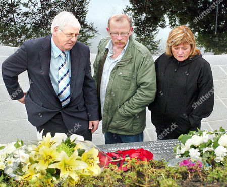Omagh Bomb victims' family members Michael Gallagher (left),  with Godfrey and Anne Wilson visiting the newly opened Garden of Light in the town just hours after they had boycotted the official opening service to mark the tenth anniversary of the joint Real IRA/Continuity IRA car bomb attack that claimed thirty-one lives including eight month term unborn twins.  Michael's son Aiden died and the Wilson's daughter Lorraine was killed.  Ten of the victims familes are angry about some of those who attended the service on Friday and about a lack of consultation on the form the memorial to the victims should take. They refused to attend the official remembrance event and will hold a service of remembrance themselves on Sunday at three o'clock.
