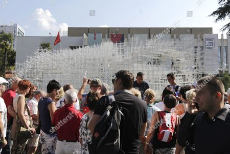 A Group of Tourists Visit the 541 Square Meters Structure Called 'The Cloud' Made by Japanese Artist Sou Fujimoto is Displayed at the Centre of Tirana Albania 27 September 2016 the Artwork Has Two Entrances and was Created For the Visitors to Interact with the Walls Seating and Roof of the Structure That Were Made From Steel Albania Tirana