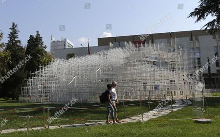 A Couple Visit the 541 Square Meters Structure Called 'The Cloud' Made by Japanese Artist Sou Fujimoto is Displayed at the Centre of Tirana Albania 27 September 2016 the Artwork Has Two Entrances and was Created For the Visitors to Interact with the Walls Seating and Roof of the Structure That Were Made From Steel Albania Tirana