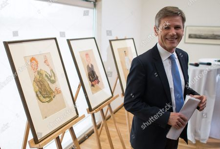Austrian Federal Minister For Arts and Culture Constitution and Public Service Josef Ostermayer Poses Next to Nazi-looted Drawings by Austrian Artist Egon Schiele (1890-1918) During a Press Conference at the Leopold Museum in Vienna Austria 07 April 2016 the Museum and the Jewish Community Vienna Achieved an Agreement to Return the Two Drawings 'Sitzender Bub Mit Gefalteten Haenden' (lit: Sitting Boy with Folded Hands) From 1910 (c) and 'Selbstdarstellung Mit Gestreiften Aermelschonern' (lit: Self Portrait with Striped Sleeves Protectors) From 1915 (l) to the Heiress of Late Austrian Art Collector Karl Maylaender Three Other Drawings of the Collection of Maylaender Remain at the Leopold Museum Austria Vienna