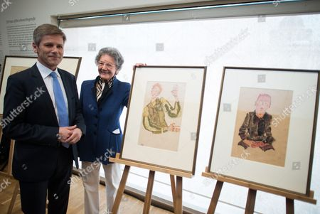 Stock Photo of Austrian Federal Minister For Arts and Culture Constitution and Public Service Josef Ostermayer (l) and Elisabeth Leopold Widow of Late Art Collector Rudolf Leopold (r) Pose Next to Nazi-looted Drawings by Austrian Artist Egon Schiele (1890-1918) During a Press Conference at the Leopold Museum in Vienna Austria 07 April 2016 the Museum and the Jewish Community Vienna Achieved an Agreement to Return the Two Drawings 'Sitzender Bub Mit Gefalteten Haenden' (lit: Sitting Boy with Folded Hands) From 1910 (r) and 'Selbstdarstellung Mit Gestreiften Aermelschonern' (lit: Self Portrait with Striped Sleeves Protectors) From 1915 (l) to the Heiress of Late Austrian Art Collector Karl Maylaender Three Other Drawings of the Collection of Maylaender Remain at the Leopold Museum Austria Vienna