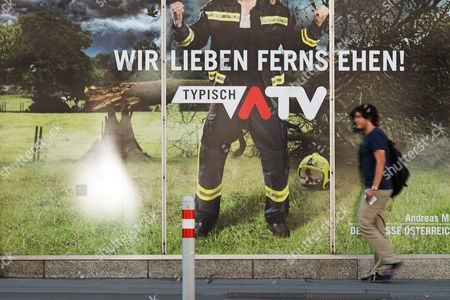A Man Passes by an Advertisement of Austrian Commercial Television Station Atv in Vienna Austria 31 August 2016 Slogan on Poster Reads: 'We Love Television Typical Atv' According to Austrian and German Media Austrian Shareholder of Atv and Owner of the German Media Company Tele Muenchen Gruppe (tmg) Herbert Kloiber Plans to Sell Atv in 2017 Due to Financial Losses in Recent Years Austria Vienna