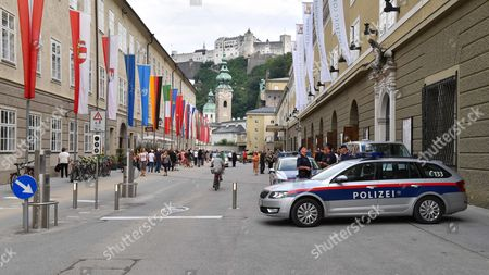 Police Cars Stand in the Hofstallgasse Prior to the Premiere of Thomas Ades' Opera 'The Exterminating Angel' During the Salzburg Festival in Salzburg Austria 28 July 2016 the Festival Runs From 22 July to 31 August Austria Salzburg