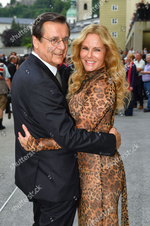 Austrian Journalist and Manager Hans Mahr (l) and His Wife German Television Presenter Katja Burkard Arrive Prior to the Premiere of Thomas Ades' Opera 'The Exterminating Angel' During the Salzburg Festival in Salzburg Austria 28 July 2016 the Festival Runs From 22 July to 31 August Austria Salzburg