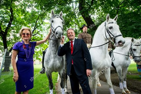 Austrian Minister of Agriculture Forestry Environment and Water Management Andra Rupprechter (r) and Managing Director of the Spanish Riding School Elisabeth Guertler (l) Pose For Photographs Next to Riders of the Spanish Riding School on Horseback at the 'Burggarten' Park in Vienna Austria 02 June 2016 After the Spanish Riding School was Admitted to the Unesco World Heritage List of Intangible Cultural Heritage of Humanity Austria Vienna