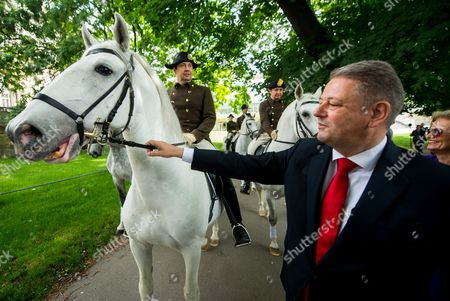 Austrian Minister of Agriculture Forestry Environment and Water Management Andra Rupprechter Poses For Photographs Next to Riders of the Spanish Riding School on Horseback at the 'Burggarten' Park in Vienna Austria 02 June 2016 After the Spanish Riding School was Admitted to the Unesco World Heritage List of Intangible Cultural Heritage of Humanity Austria Vienna