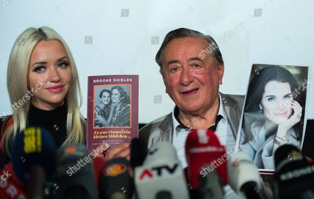 Austrian Businessman Richard Lugner (r) and His Wife Cathy Schmitz Hold Up Photos of Us Actress Brooke Shields During a Press Conference at the Shopping Mall 'Lugner City' in Vienna Austria 13 January 2016 Shields Will Accompany Lugner to the Vienna Opera Ball 2016 As His Special Guest on 04 February Austria Vienna