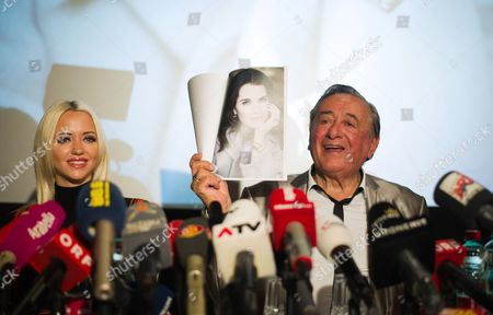 Stock Picture of Austrian Businessman Richard Lugner (r) and His Wife Cathy Schmitz Hold Up Photos of Us Actress Brooke Shields During a Press Conference at the Shopping Mall 'Lugner City' in Vienna Austria 13 January 2016 Shields Will Accompany Lugner to the Vienna Opera Ball 2016 As His Special Guest on 04 February Austria Vienna
