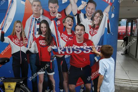 A Young Olympic Spectator Plays with a Giant Picture of Russian Supporters in Front of the Official Russia House at Fort Copacabana in Rio De Janeiro Brazil 07 August 2016 the Russian Team Will not Be Allowed to Compete in the Rio 2016 Paralympic Games the Head of the International Paralympic Committee (ipc) Sir Philip Craven Announced 07 August with 21 Days Allowed For Russia to Appeal the Ban Brazil Rio De Janeiro