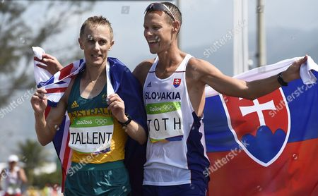 Stock Image of Matej Toth (r) of Slovakia Celebrates After Winning the Gold Medal in the Men's 50km Race Walk of the Rio 2016 Olympic Games Athletics Track and Field Events in Pontal in Rio De Janeiro Brazil 19 August 2016 Toth Won Ahead of Second Placed Jared Tallent (l) of Australia Brazil Rio De Janeiro
